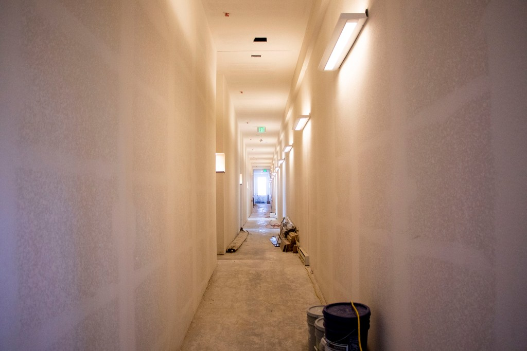 An unfinished hallway inside a new housing project at Laradon in Globeville. Nov. 8, 2019. (Kevin J. Beaty/Denverite)