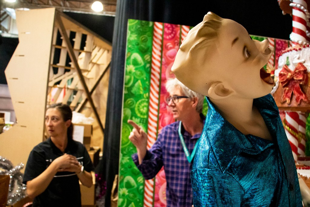 "Lonnie Hanzon (purple) works as a mannequin yells. ""Camp Christmas"" is under construction at Stanley Marketplace. Nov. 15, 2019. (Kevin J. Beaty/Denverite)"