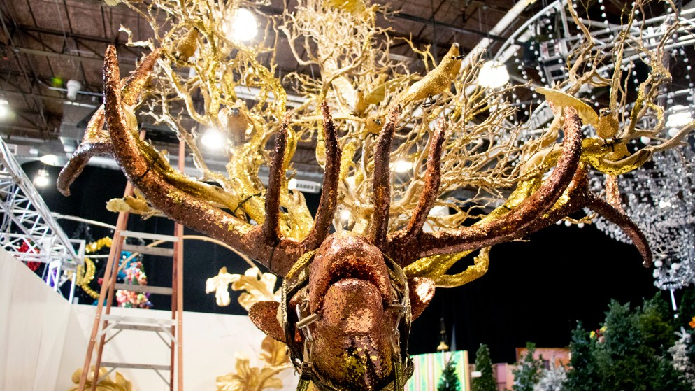 "Here is a shiny elk. Lonnie Hanzon's ""Camp Christmas"" is under construction at Stanley Marketplace. Nov. 15, 2019. (Kevin J. Beaty/Denverite)"