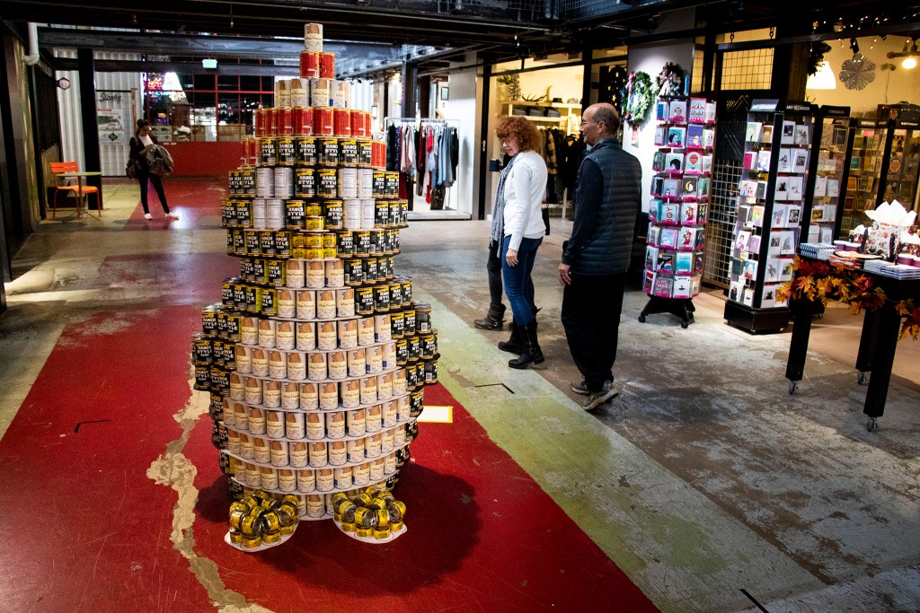 """Chili"" Willy the Penguin, who made out of canned chili supplies, was just born at ""can-struction,"" We Don't Waste's art show at Stanley Marketplace. Nov. 15, 2019. (Kevin J. Beaty/Denverite)"