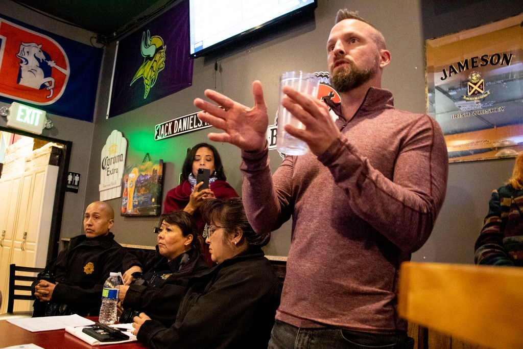 A Curtis Park resident, who declined to be named, raises concerns about the alleyway behind his house during a meeting on homelessness facilitated by District 9 City Councilwoman Candi CdeBaca at Jack Rabbit Slims. Cole, Nov. 21, 2019. (Kevin J. Beaty/Denverite)