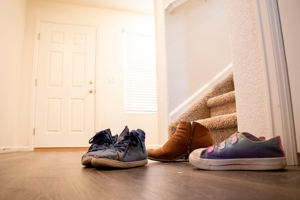 Shoes belonging to Mele Lavaka and her boyfriend's kids by the door in her new home in Lochbuie, Colorado. Nov. 28, 2019. (Kevin J. Beaty/Denverite)