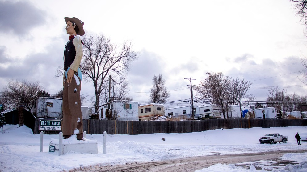 John Sutton's giant, nameless cowboy which guards Rustic Ranch Mobile Home and RV Park off Federal Boulevard. Nov. 26. 2019. (Kevin J. Beaty/Denverite)