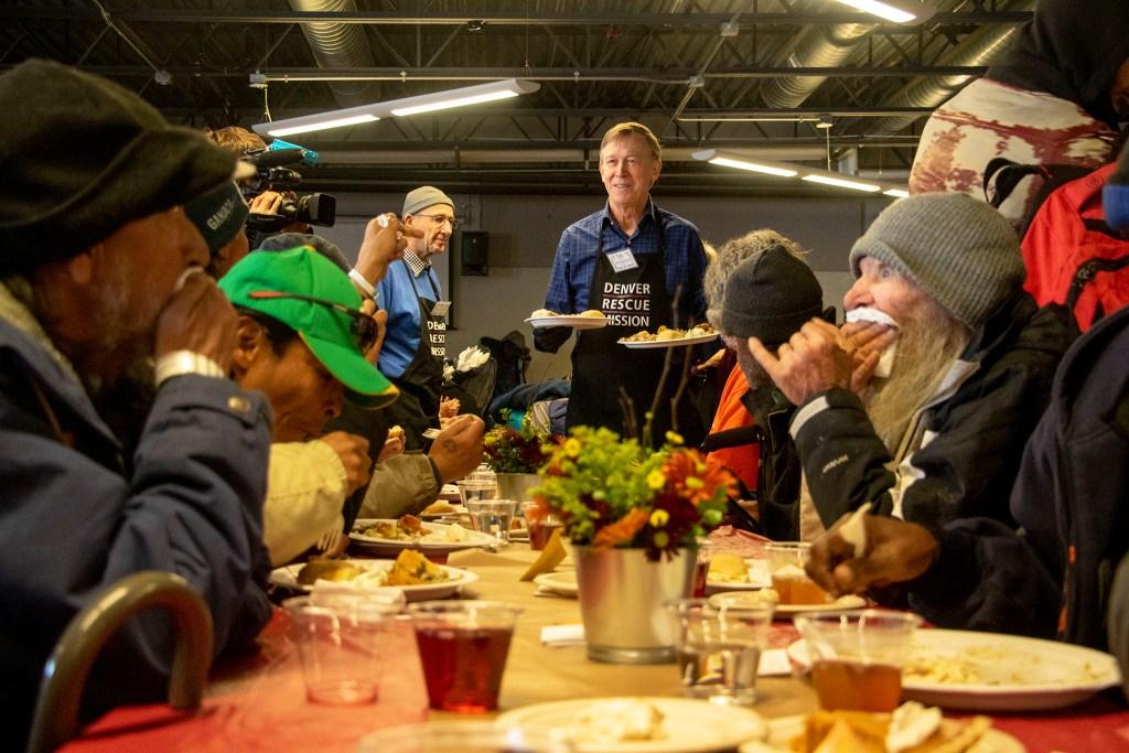 Former Gov. John Hickenlooper serves meals during a Thanksgiving feast at the Denver Rescue Mission, Nov. 27, 2019. (Kevin J. Beaty/Denverite)