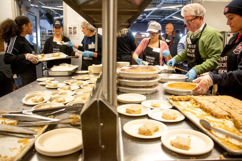 Volunteers prepare dessert during a Thanksgiving feast at the Denver Rescue Mission, Nov. 27, 2019. (Kevin J. Beaty/Denverite)