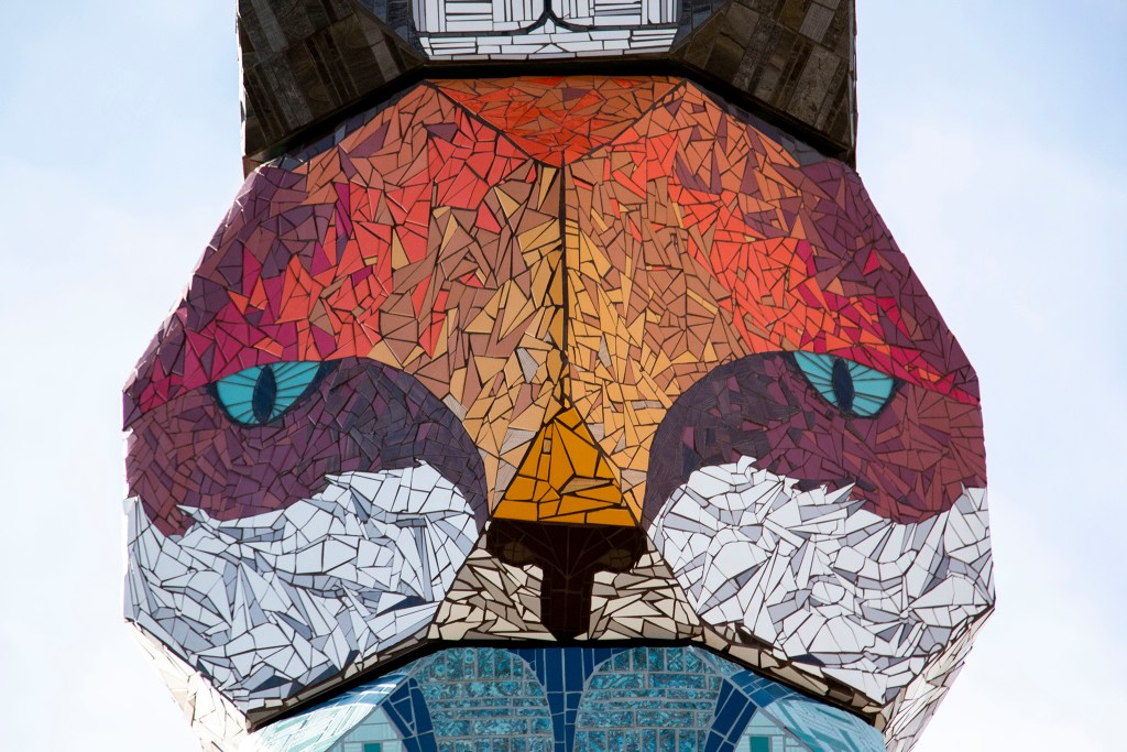 "A fox face in Jaime Molina's ""La Veleta/The Weathervane"" towering above Federal Boulevard from its new home at Barnum Park. Dec. 14, 2019. (Kevin J. Beaty/Denverite)"