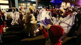 The Dia de Muertos parade along Santa Fe Drive on Friday, Nov. 1, in Denver. (Esteban L. Hernandez/Denverite)