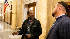 Jerry Burton and Ean Tafoya chat outside of the Denver City Council chamber, Jan. 6, 2020. (Kevin J. Beaty/Denverite)