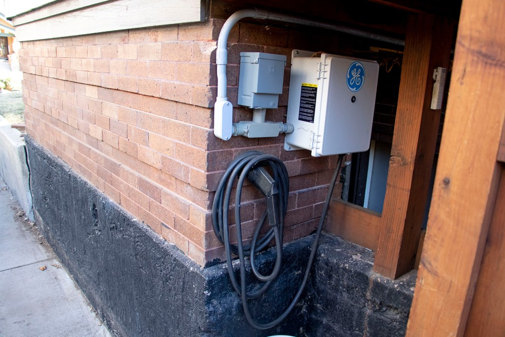 An electric car charging station installed in George Dennis' storied North Park Hill home. Jan. 15, 2019. (Kevin J. Beaty/Denverite)