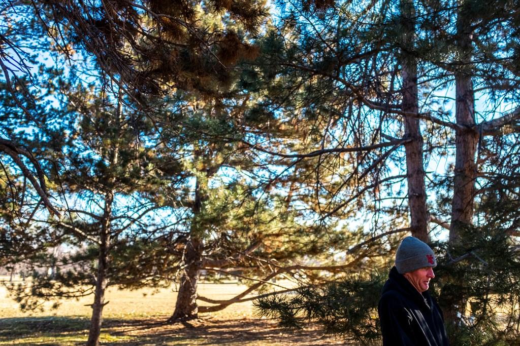 Navy veteran Kelly Smith speaks to a reporter under the City Park tree he slept next to last night. Jan. 28, 2020. (Kevin J. Beaty/Denverite)