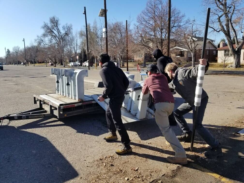 B-cycle workers extract a dock from Louisiana and Franklin. (Courtesy, Denver B-cycle)