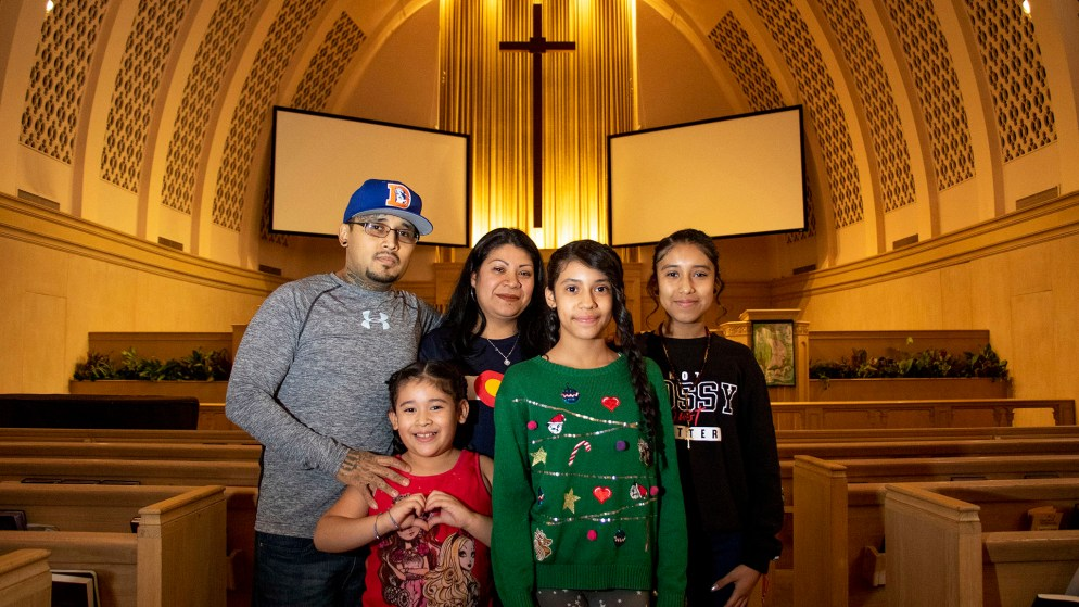 Jorge Ávila, his wife, Alejandra, and their daughters, Sherlyn, Zaira and Fatima, pose for a portrait inside Park Hill United Methodist Church's sancturary. Feb. 11, 2020. (Kevin J. Beaty/Denverite)