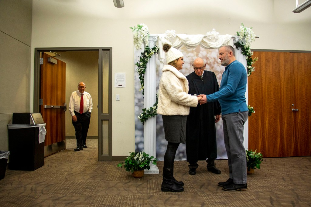 Megan Temple and Eric Kelley get hitched on Valentine's Day at the office of Denver's Clerk and Recorder, Feb. 14, 2020. (Kevin J. Beaty/Denverite)