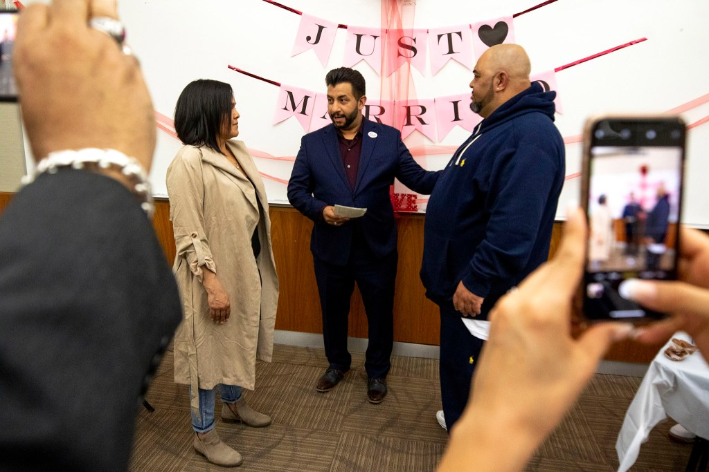 Denver Clerk and Recorder Paul Lopez officiates the wedding of Tyree and Yvonne Wilson on Valentine's Day Feb. 14, 2020. (Kevin J. Beaty/Denverite)