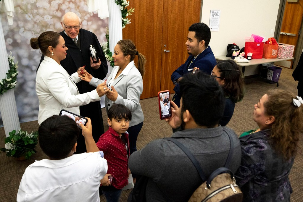 Leticia Hernandez (left) and Elizabeth Reyes are married on Valentine's Day at the office of Denver's Clerk and Recorder, Feb. 14, 2020. (Kevin J. Beaty/Denverite)