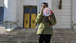 Denver Homeless Out Loud activist Jerry Burton speaks at a Feb. 21, 2020 protest of a visit to Denver by Robert Marbut, executive director of the U.S. Interagency Council on Homelessness. (Donna Bryson/Denverite)