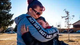 Christina Zalvidar comforts her youngest son, Francysco, as she drops him off at school. His father will be deported soon, and she's leaving this morning for Mexico to meet him. Jan. 9, 2020. (Kevin J. Beaty/Denverite)
