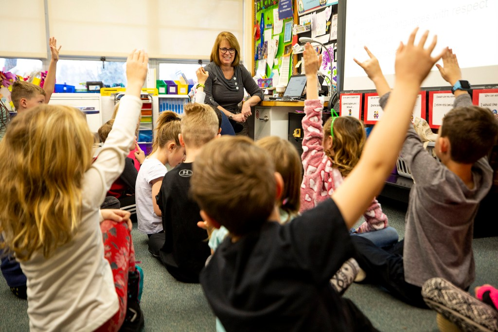 Terri Ruffennach fields questions from second-graders at Carson Elementary, March 13, 2020. (Kevin J. Beaty/Denverite)