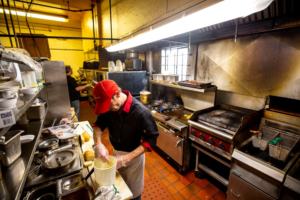 Dustin Carrera at work in Bonnie Brae Tavern's kitchen, March 21, 2020. (Kevin J. Beaty/Denverite)