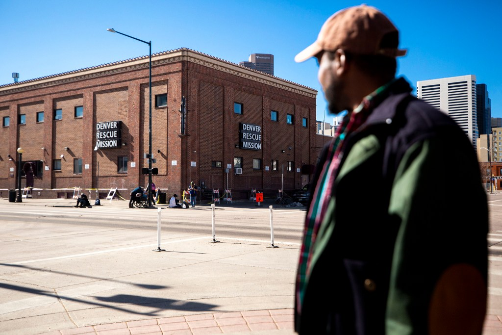 Davon Moss speaks to a reporter in  front of the Denver Rescue Mission and Samaritan House. March 24, 2020. (Kevin J. Beaty/Denverite)