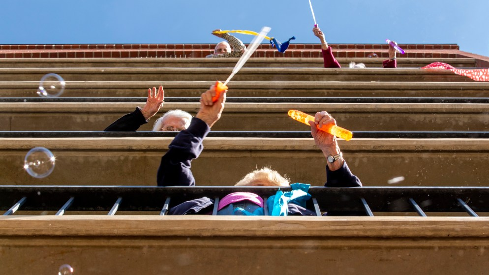 Residents of the Springbrooke Senior Living center sing and dance above their courtyard. Washington Virginia Vale, March 27, 2020. (Kevin J. Beaty/Denverite)