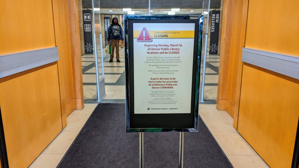 A sign posted Friday, March 13, 2020 at the entrance to Denver's main library announces the facility will be closed indefinitely starting Monday, March 16, 2020 because of coronavirus. (Donna Bryson/Denverite)