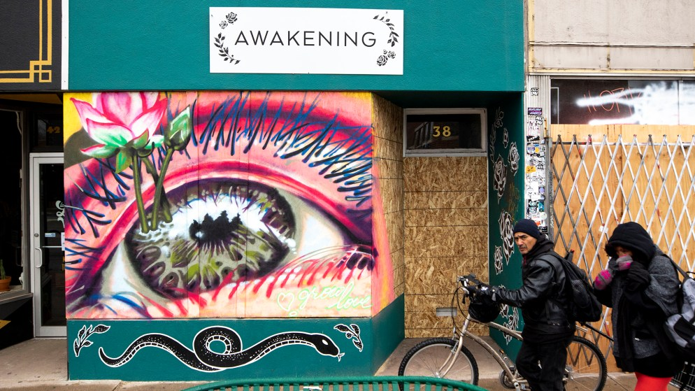 Awakening Boutique on Broadway is boarded up and muraled. April 2, 2020. (Kevin J. Beaty/Denverite)