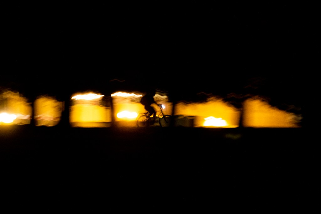 A cyclist rides 'round Cheesman Park. April 7, 2020. (Kevin J. Beaty/Denverite)