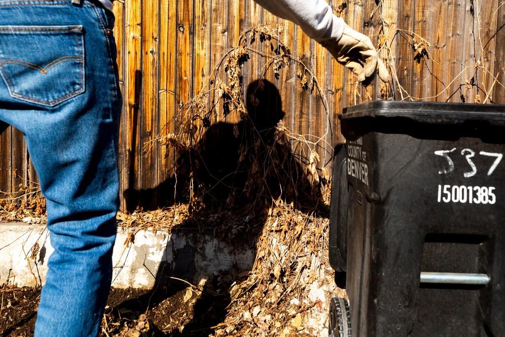 Steve Nissen cleans an alleyway near 5th Avenue and Emerson Street. April 9, 2020. (Kevin J. Beaty/Denverite)