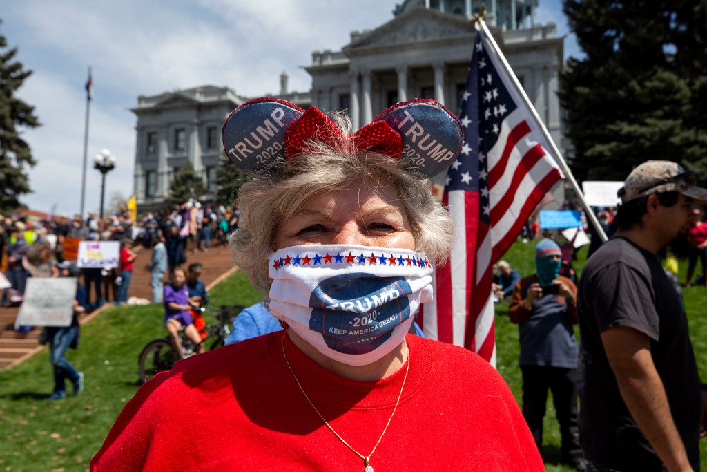 Connie Gulden wears a Trump-branded facemask at a protest demanding the end to Colorado's stay-at-home order. April 19, 2020. (Kevin J. Beaty/Denverite)