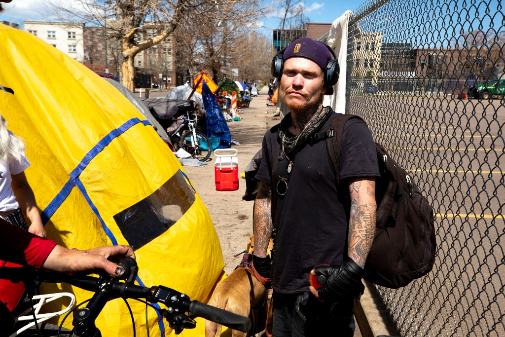 JJ Wood stands near the place where he's been camping along Stout Street. April 28, 2020. (Kevin J. Beaty/Denverite)