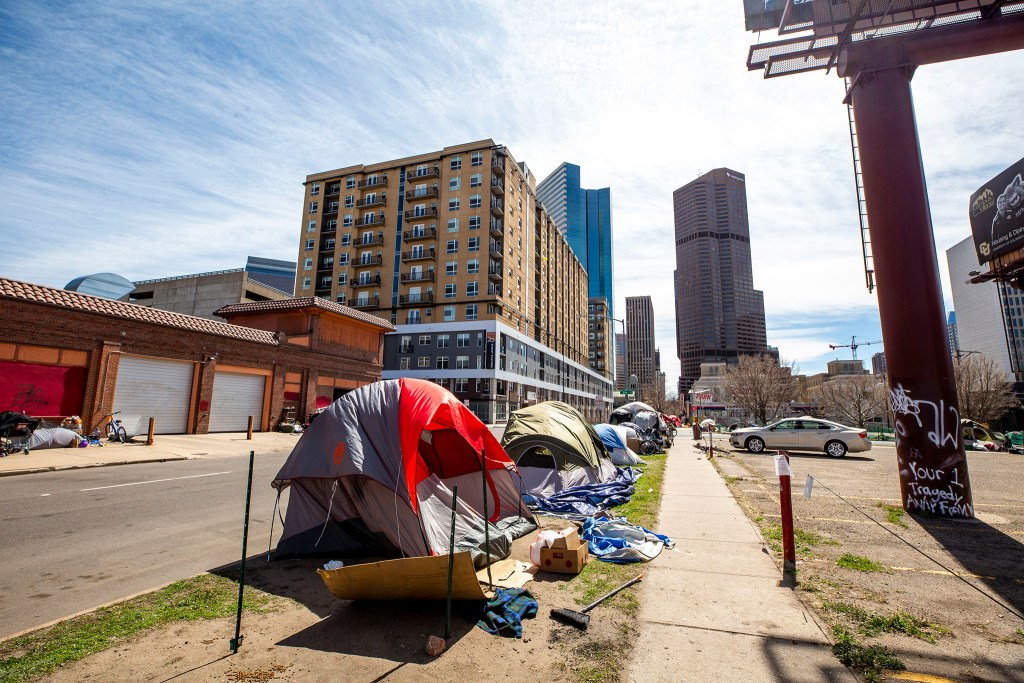 "Tents line California Street days before a ""multi-agency cleanup"" by the city. April 28, 2020. (Kevin J. Beaty/Denverite)"