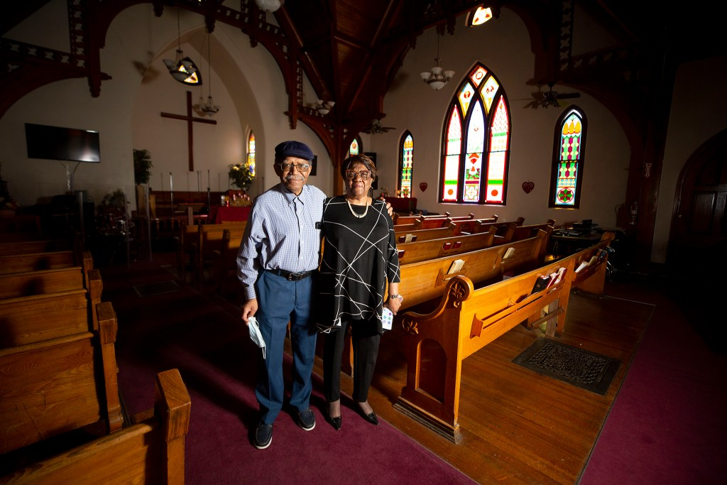 Robert and Eddie Mae Woolfolk stand inside the Agape Christian Church in Five Points. May 1, 2020. (Kevin J. Beaty/Denverite)