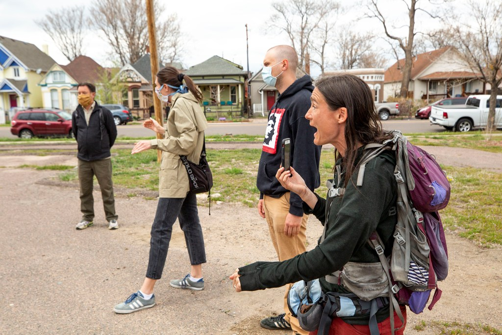 Terese Howard argues with members of the Curtis Park RNO in the vacant lot at 33rd and Curtis Streets in Five Points. May 2, 2020. (Kevin J. Beaty/Denverite)