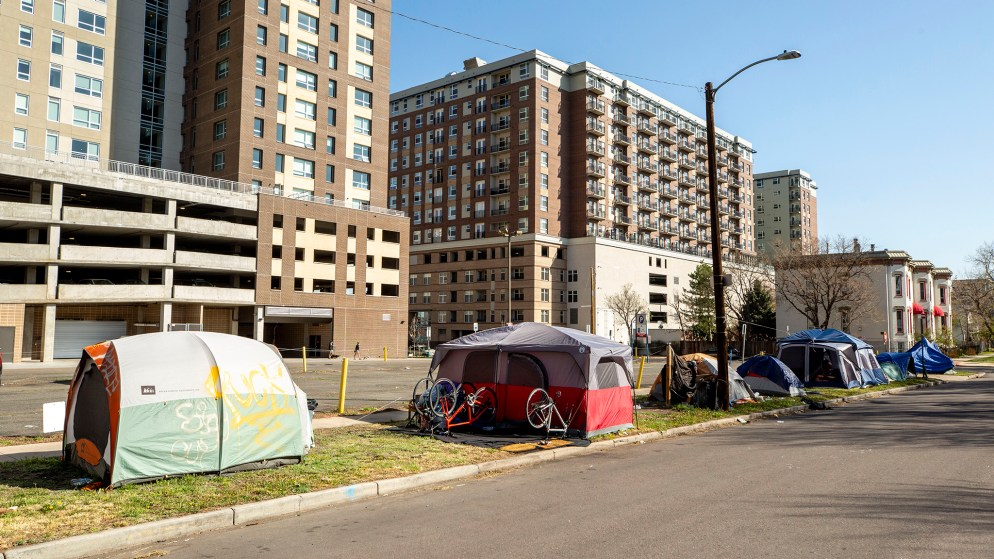 People forced to move tents during recent city cleanups have resettled here along Glenarm Place. May 7, 2020. (Kevin J. Beaty/Denverite)
