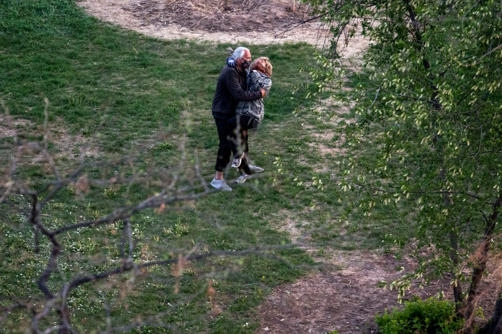 "A couple dances in Cheesman Park as Jim Scharper blasts ""Moondance"" by Van. Morrison. May 7, 2020. (Kevin J. Beaty/Denverite)"