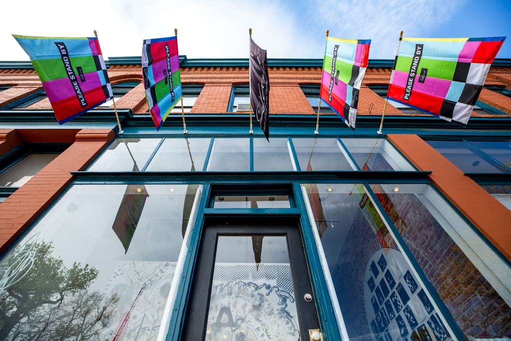 City Park West's Leon Gallery got some new flags. May 13, 2020. (Kevin J. Beaty/Denverite)