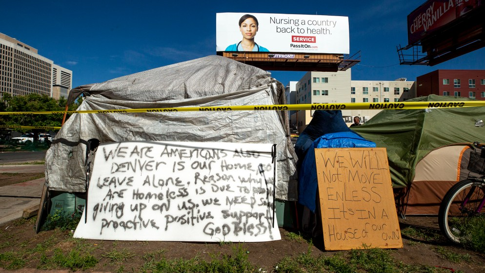 Signs posted at the encampments near the intersection of California and 21st Streets during a multi-agency cleanup. May 27, 2020. (Kevin J. Beaty/Denverite)