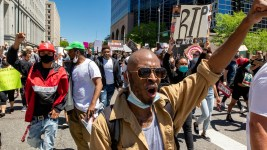 Protesters marched Friday, rallying against police brutality and calling on the police involved in George Floyd's death to be charged with murder. (Kevin J. Beaty/Denverite)
