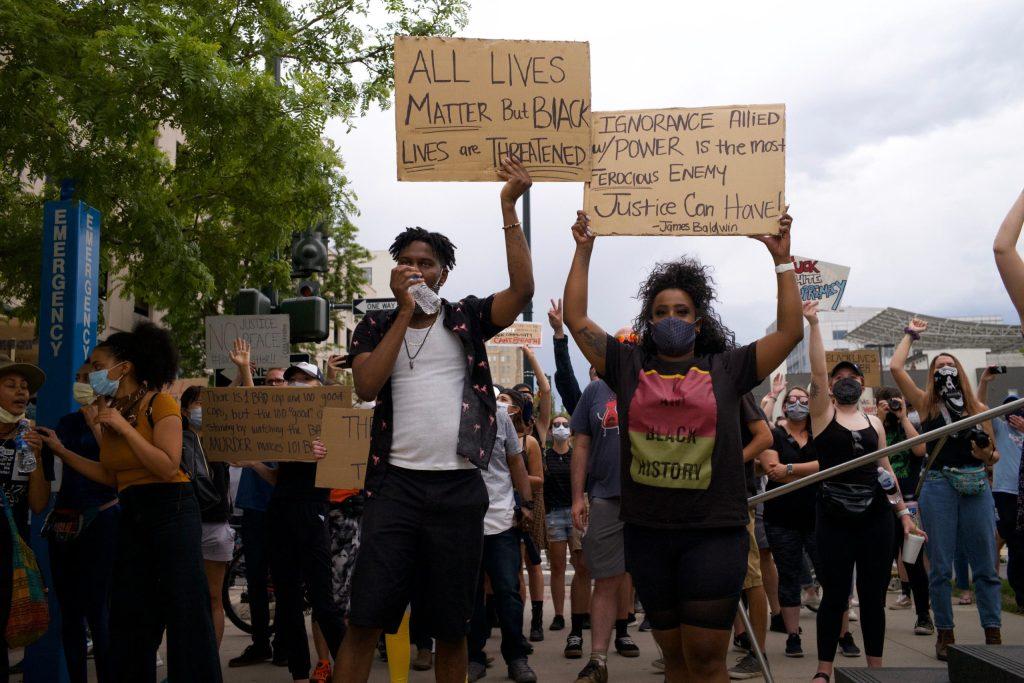 Hundreds of protesters march in Denver on Sunday, May 31, 2020. (Carl Glenn Payne/For Denverite)