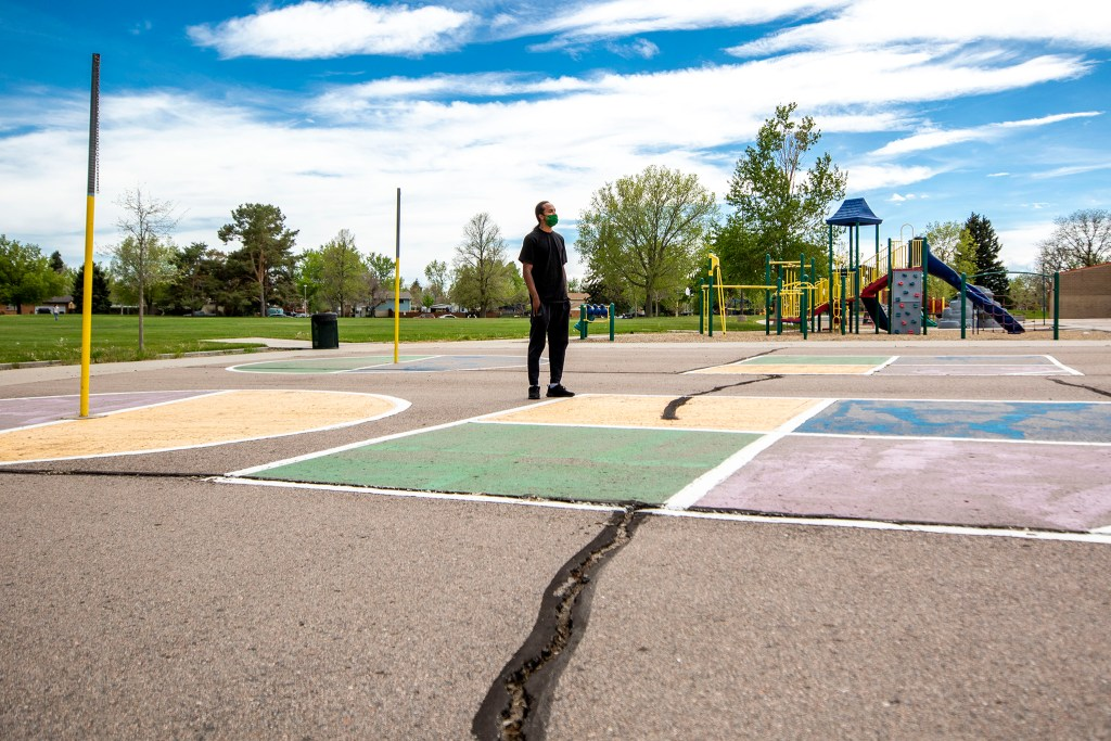 Eris Griffin stands in a Montbello park where he remembers hanging out with many neighborhood kids on Sundays. May 17, 2020. (Kevin J. Beaty/Denverite)