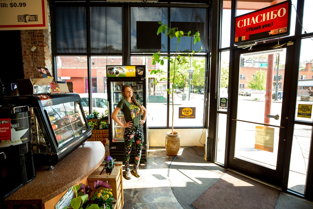 Caitlin Searle and her avocado tree, which she grew from a fruit she got at her store, Capitol Convenience, in Capitol Hill. May 28, 2020. (Kevin J. Beaty/Denverite)