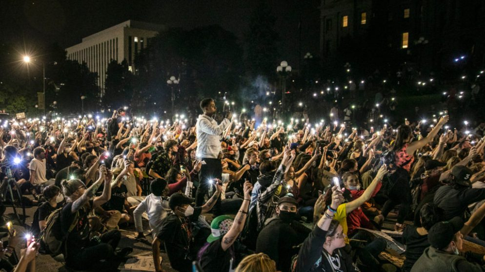 After speeches at Civic Center Park, the protesters against police brutality moved to Lincoln Street in front of the state Capitol on Wednesday, June 3, 2020. At about 10 p.m. — an hour past curfew — they held phones aloft and stayed silent for nine minutes in honor of George Floyd, the African American man who was killed by Minneapolis police. Denver police blocked off the roads around the Capitol to give the demonstrators room but otherwise held their distance at least until 11 p.m.