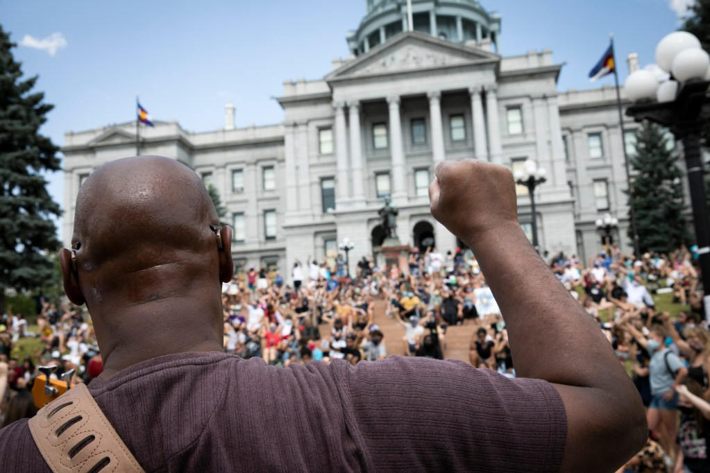 A student-led demonstration supporting Black Lives Matter, organized by DSST: College View High School in Denver, marched from Cheeseman Park to the Capitol on Tuesday, June 16, 2020. Musician Walker Groves joins the students in a moment of silence.