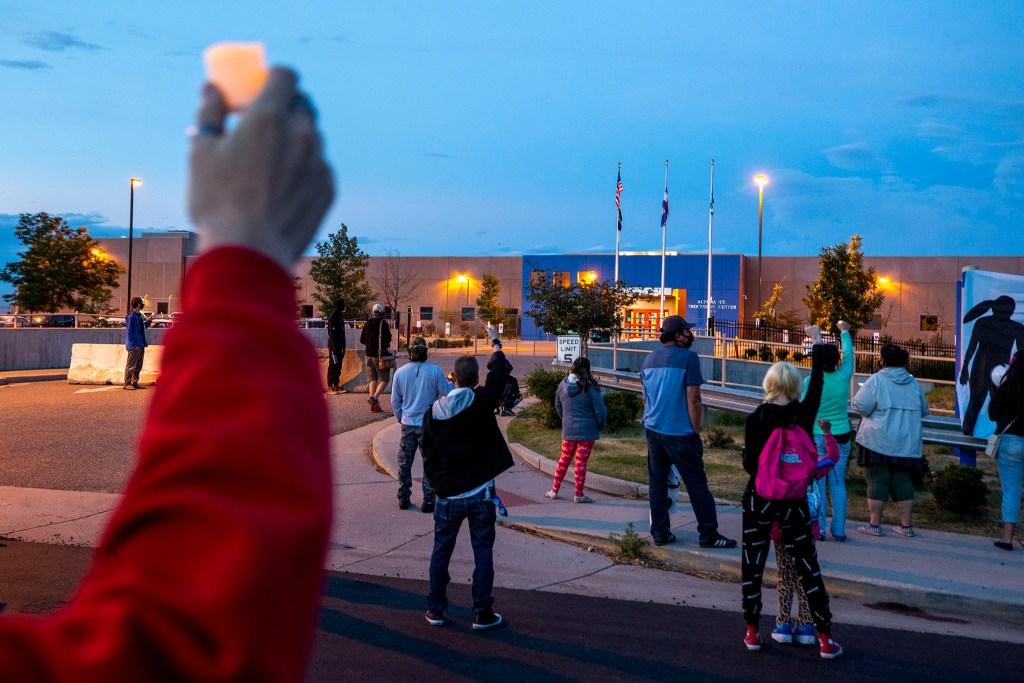 A Father's Day vigil outside of ICE's Aurora Contract Detention Facility. June 21, 2020. (Kevin J. Beaty/Denverite)