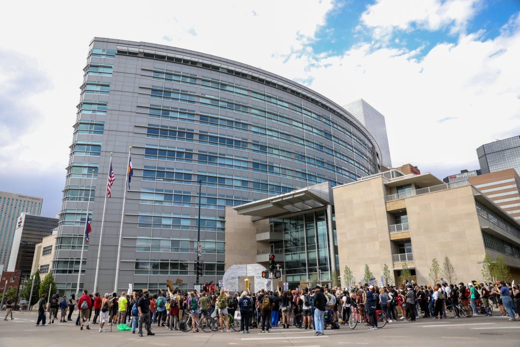 Demonstrators protest the death of William DeBose outside the Denver DA's office after marching from the Capitol June 18, 2020.