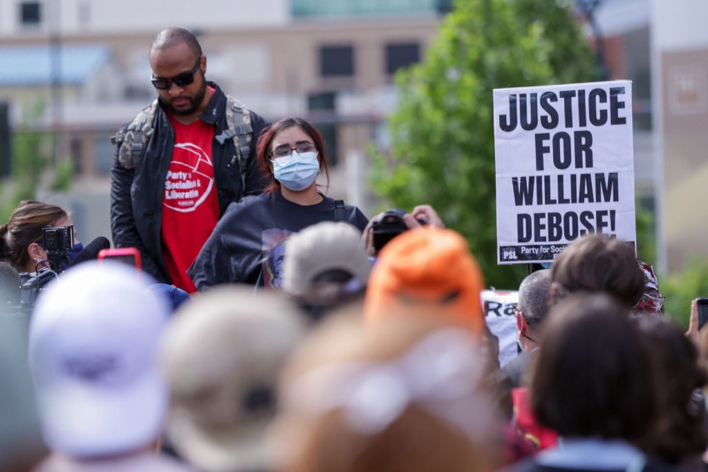 The late William DeBose's wife wife Sierra Martinez speaks to supporters outside the Denver DA's office.