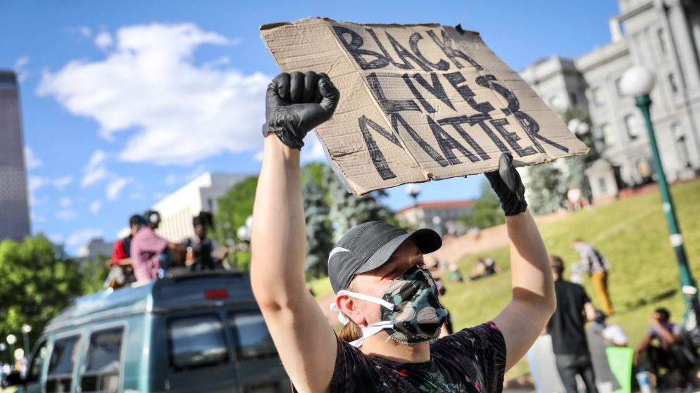 Ian Downs, of Denver, joins protesters against racism and police brutality on Lincoln Street below the Capitol on Wednesday evening, June 10, 2020.