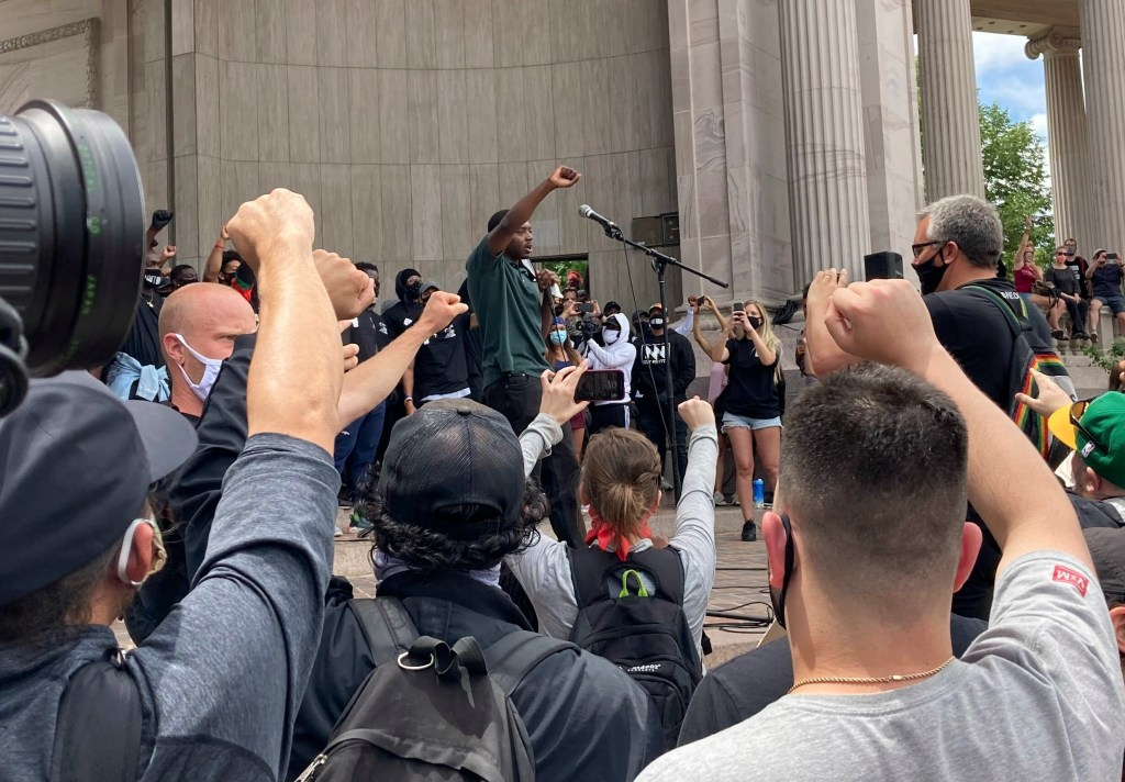 Neil Yarbrough leads a chant at a protest at Denver's Civic Center Park Saturday, June 6, 2020.