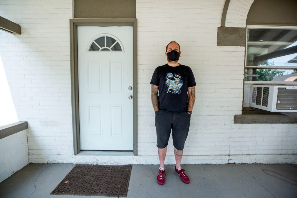 Software engineer Guy Grigsby stands outside of his home on Josephine Street in Elyria Swansea. July 22, 2020.